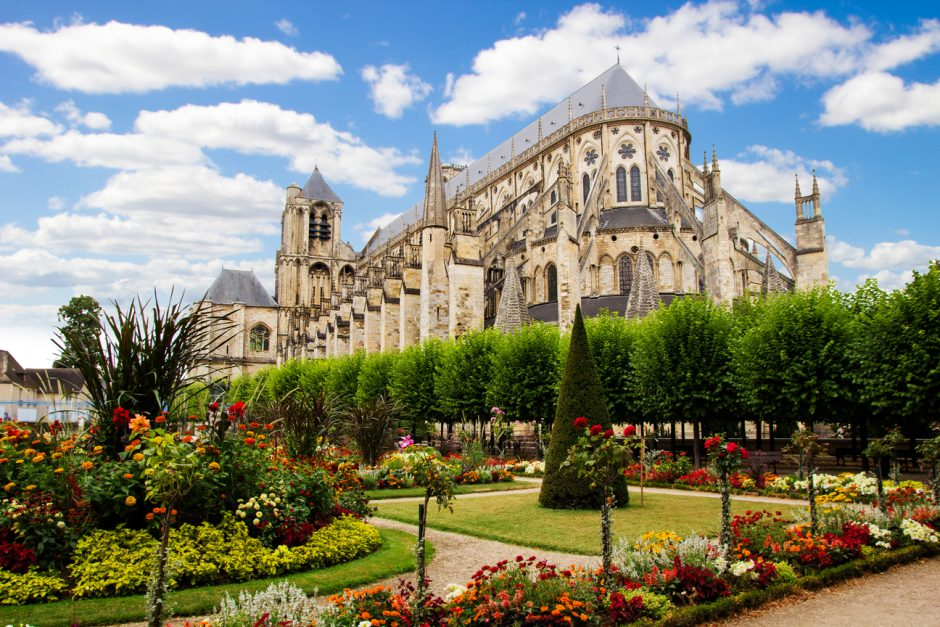 Cathedral in Bourges, beautiful garden France. Sunny day