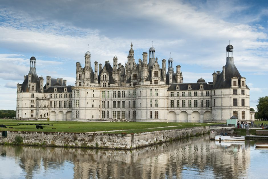Chambord - France - August 21, 2008: The facade of Chambord Castle, a very famous medieval castle of the French Renaissance architecture. Tourists in the photo.